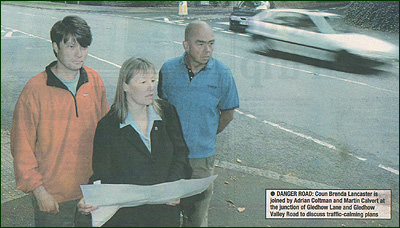 Councillor Brenda Lancaster is joined by Adrian Coltman and Martin Calvert at the junction of Gledhow Lane and Gledhow Valley Road to discuss traffic calming plans.