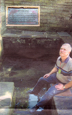 Wonder: Mervyn Clayton, a member of Friends of Gledhow Valley Woods, sits near the plunge pool which is fed by a natural spring within the bath house