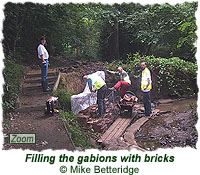 Filling the gabions with bricks