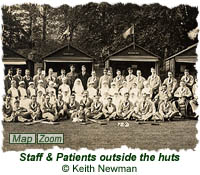 Staff & patients outside the huts